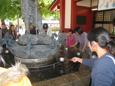 People washing their hands before entering Senso-ji Temple