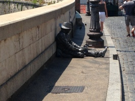 A guy near Castel Sant'Angelo in hot sunny weather !